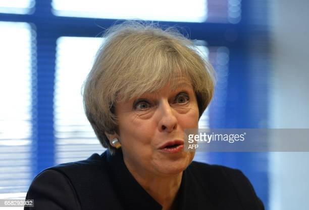 Britain's Prime Minister Theresa May meets officers from Police Scotland at Govan Police station in Govan, west Scotland, on March 27 where she...