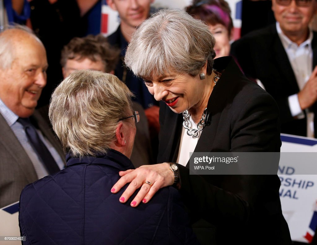 Britain's Prime Minister Theresa May meets supporters after delivering a speech to Conservative Party members to launch their election campaign in Walmsley Parish Hall on April 19, 2017 in Bolton, England. MPs in Parliament have today backed British Prime Minister Theresa May's plan to call a general election for June 8.