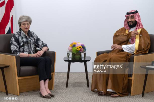 Britain's Prime Minister Theresa May meets the Crown Prince of Saudi Arabia Mohammad Bin Salman during a bilateral meeting on June 29 2019 in Osaka...