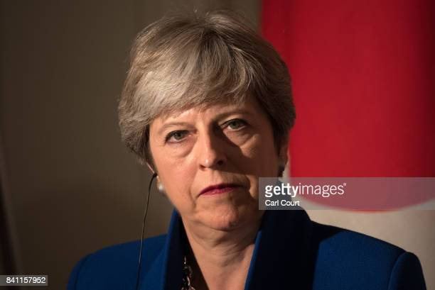 Britain's Prime Minister Theresa May pauses during a press conference with Japan's Prime Minister Shinzo Abe on August 31 2017 in Tokyo Japan Mrs May...