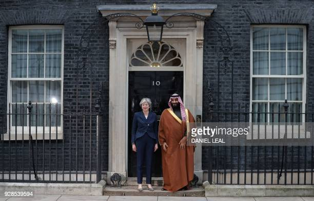 Britain's Prime Minister Theresa May poses with Saudi Arabia's Crown Prince Mohammed bin Salman outside 10 Downing Street in central London on March...