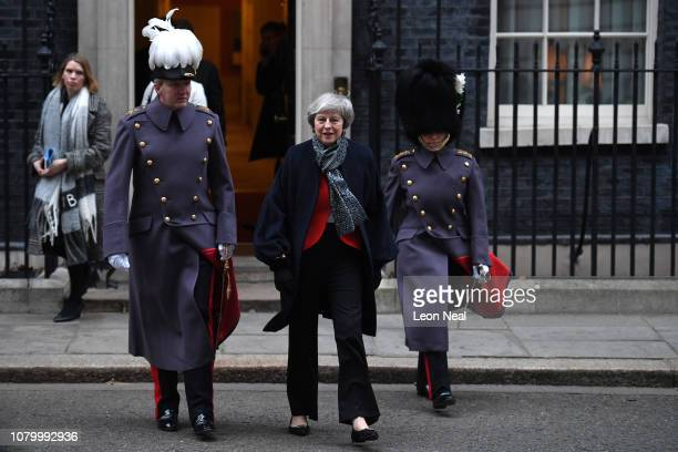 Britain's Prime Minister Theresa May prepares for the arrival of Japanese Prime Minister Shinzo Abe who will receive a military Guard of Honour for...