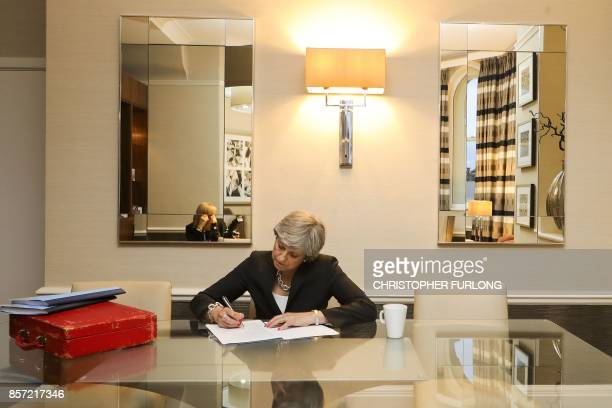 Britain's Prime Minister Theresa May prepares her conference speech in her hotel room on the third day of the Conservative Party annual conference at...