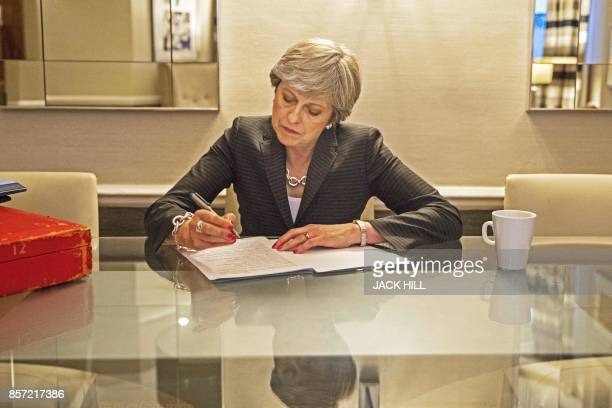 TOPSHOT Britain's Prime Minister Theresa May prepares her conference speech in her hotel room on the third day of the Conservative Party annual...