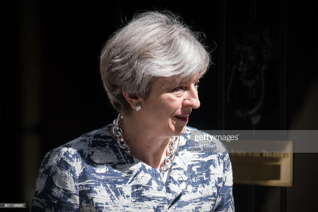 Britain's Prime Minister, Theresa May prepares to greet Arlene Foster, the leader of Northern Ireland's Democratic Unionist Party, deputy leader of the Democratic Unionist Party, Nigel Dodds and DUP MP Jeffrey Donaldson as they arrive in Downing Street on June 26, 2017 in London, England. Mrs Foster has said a deal between her party and the Conservatives to support a minority government is close.