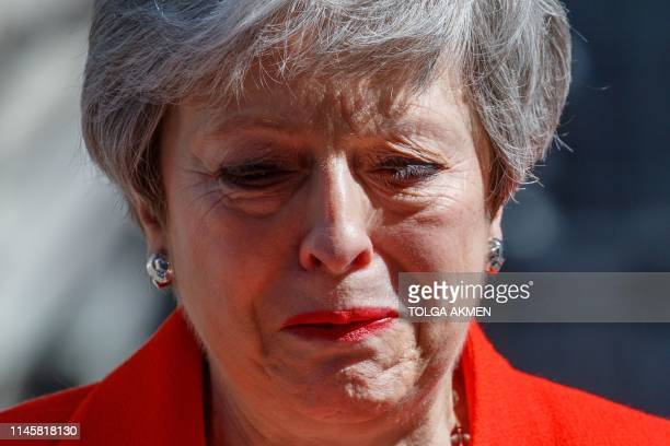 TOPSHOT Britain's Prime Minister Theresa May reacts as she announces her resignation outside 10 Downing street in central London on May 24 2019...