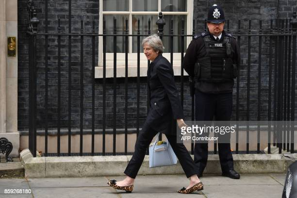 TOPSHOT Britain's Prime Minister Theresa May reacts as she arrives in Downing Street in central London on October 9 2017 British Prime Minister...