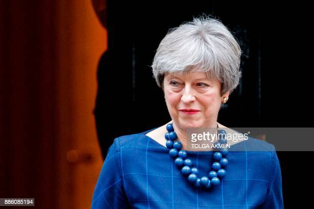Britain's Prime Minister Theresa May reacts as she prepares to greet Spain's Prime Minister outside 10 Downing Street in central London on December 5...