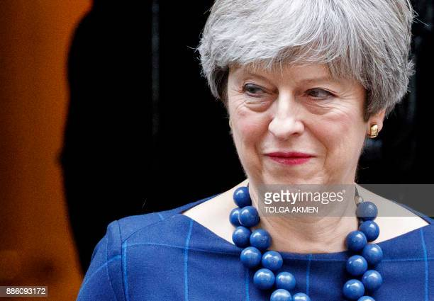 Britain's Prime Minister Theresa May reacts as she prepares to greet Spain's Prime Minister outside 10 Downing Street in central London on December...
