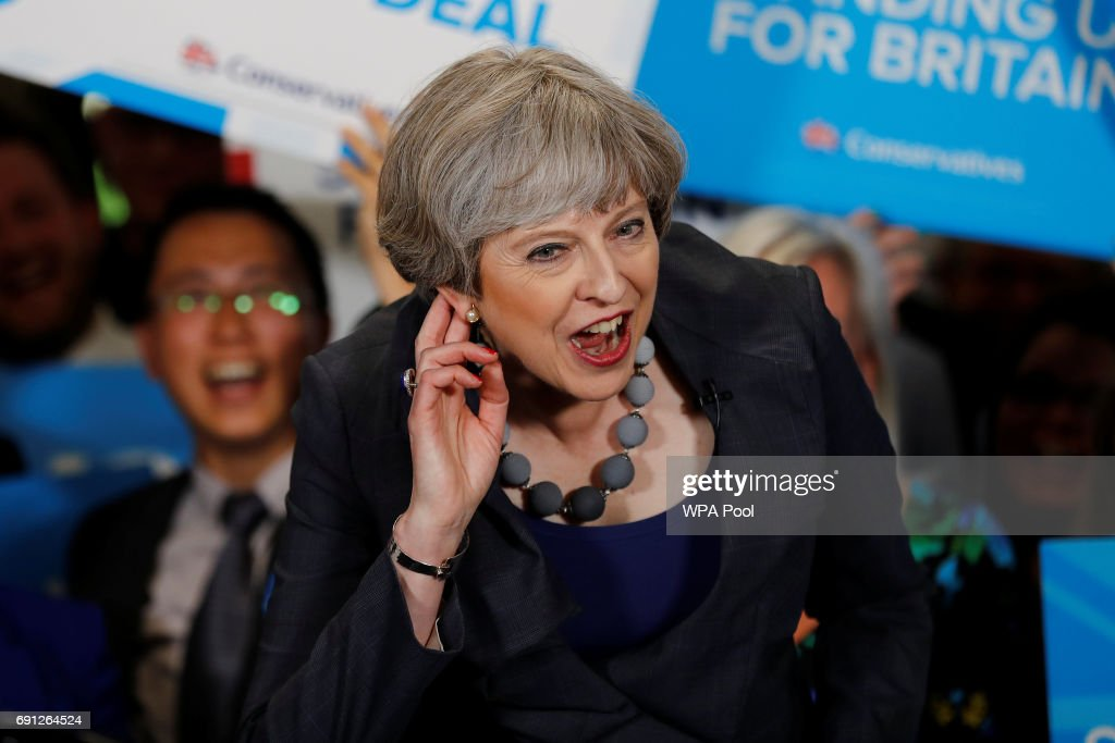 Britain's Prime Minister Theresa May reacts as she speaks at an election campaign event at Pride Park Stadium on June 1, 2017 in Derby, United Kingdom. All parties continue to campaign across the country ahead of the general election on June 8.