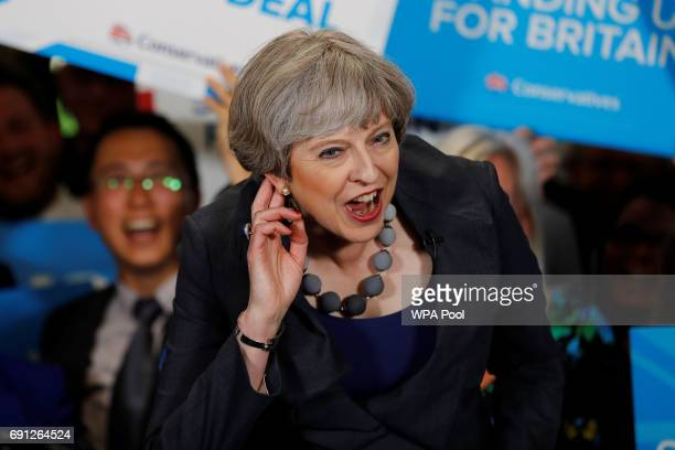 Britain's Prime Minister Theresa May reacts as she speaks at an election campaign event at Pride Park Stadium on June 1, 2017 in Derby, United...