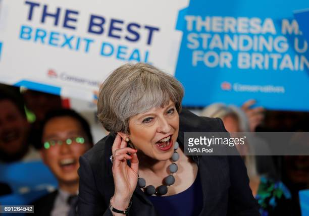 Britain's Prime Minister Theresa May reacts as she speaks at an election campaign event at Pride Park Stadium on June 1 2017 in Derby United Kingdom...