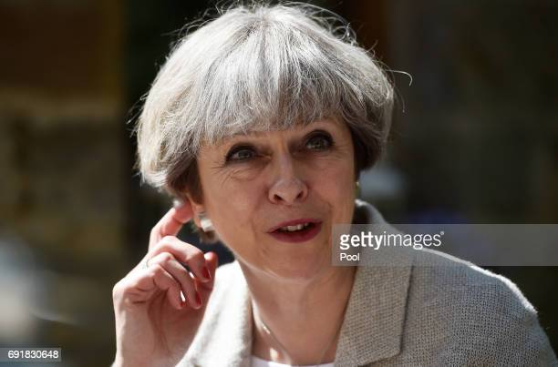 Britain's Prime Minister Theresa May reacts during an election campaign visit to Horsfields Nursery on June 3 2017 in Silkstone South Yorkshire...