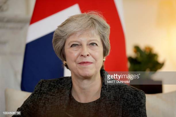 Britain's Prime Minister Theresa May reacts during her meeting with the Emir of Qatar Sheikh Tamim Bin Hamad alThani at 10 Downing Street in London...