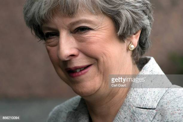 Britain's Prime Minister Theresa May returns to her hotel after attending a television interview on the first day of the annual Conservative Party...