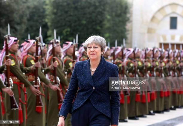 Britain's Prime Minister Theresa May reviews the Jordanian honour guard at the royal palace in Amman on November 2017 May has implored Saudi leaders...