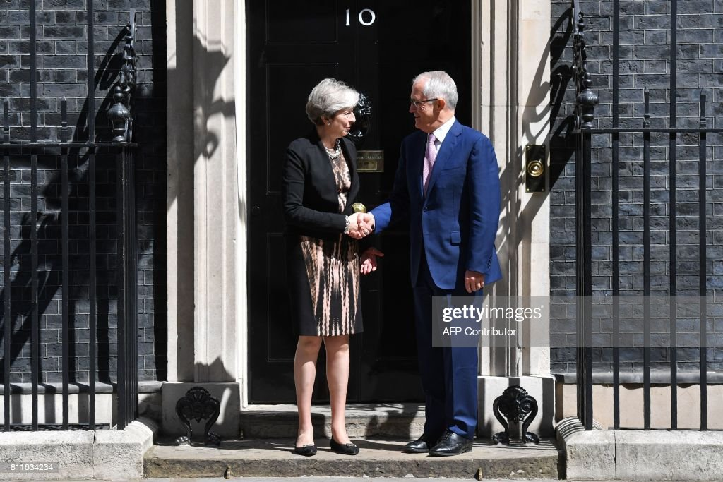 Britain's Prime Minister Theresa May (L) shakes hands with Australian Prime Minister Malcolm Turnbull outside 10 Downing Street in central London on July 10, 2017. / AFP PHOTO / Ben STANSALL