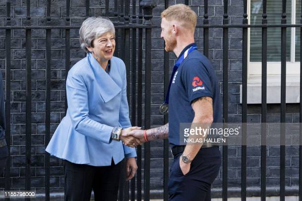 Britain's Prime Minister Theresa May shakes hands with England's Ben Stokes outside 10 Downing Street as England players arrive for a reception in...