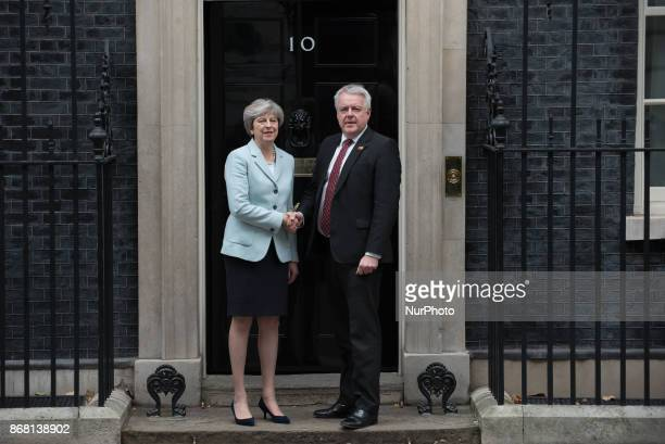 Britain's Prime Minister Theresa May shakes hands with the First Minister of Wales Carwyn Howell Jones on his arrival at no 10 Downing Street in...