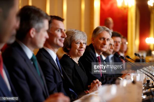 Britain's Prime Minister Theresa May sits with members of her Cabinet including Britain's Defence Secretary Gavin Williamson Britain's Foreign...