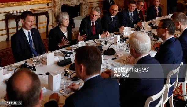 Britain's Prime Minister Theresa May sits with members of her Cabinet as she talks with Poland's Prime Minister Mateusz Morawiecki during the...