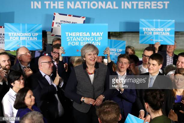 Britain's Prime Minister Theresa May smiles as she addresses an audience of supporters during a campaign stop on May 2 2017 in Bristol England The...