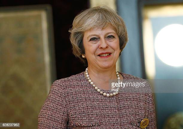 Britain's Prime Minister Theresa May smiles as she meets King of Bahrain King Hamad Bin Isa Khalifa on December 7 2016 in Manama Bahrain