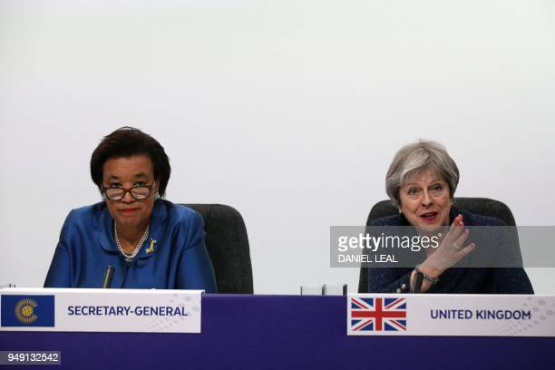 Britain's Prime Minister Theresa May speaks as Commonwealth SecretaryGeneral Patricia Scotland looks on during the closing press conference of the...