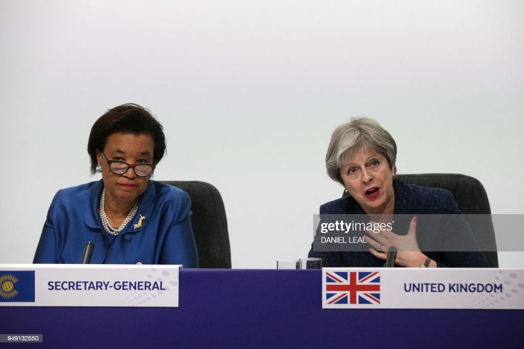 Britain's Prime Minister Theresa May (R) speaks as Commonwealth Secretary-General Patricia Scotland looks on during the closing press conference of the Commonwealth Heads of Government Meeting (CHOGM), at Marlborough House in London on April 20, 2018.