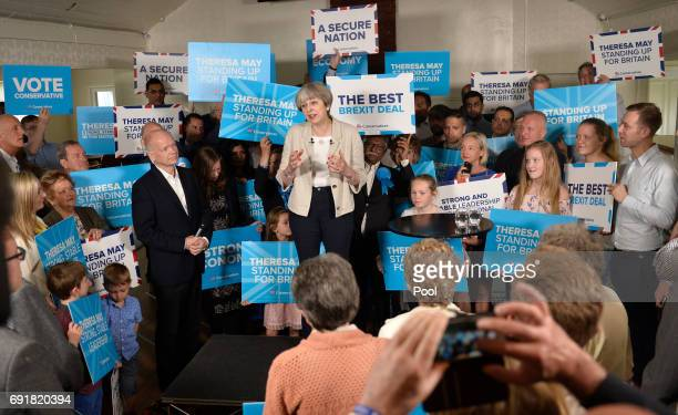 Britain's Prime Minister Theresa May speaks as former Foreign Secretary William Hague looks on at an election campaign event during a visit to West...