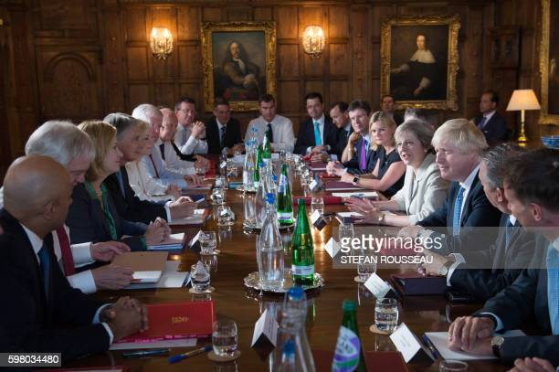 Britain's Prime Minister Theresa May speaks as she chairs a cabinet meeting sat next to British Foreign Secretary Boris Johnson at the Prime...