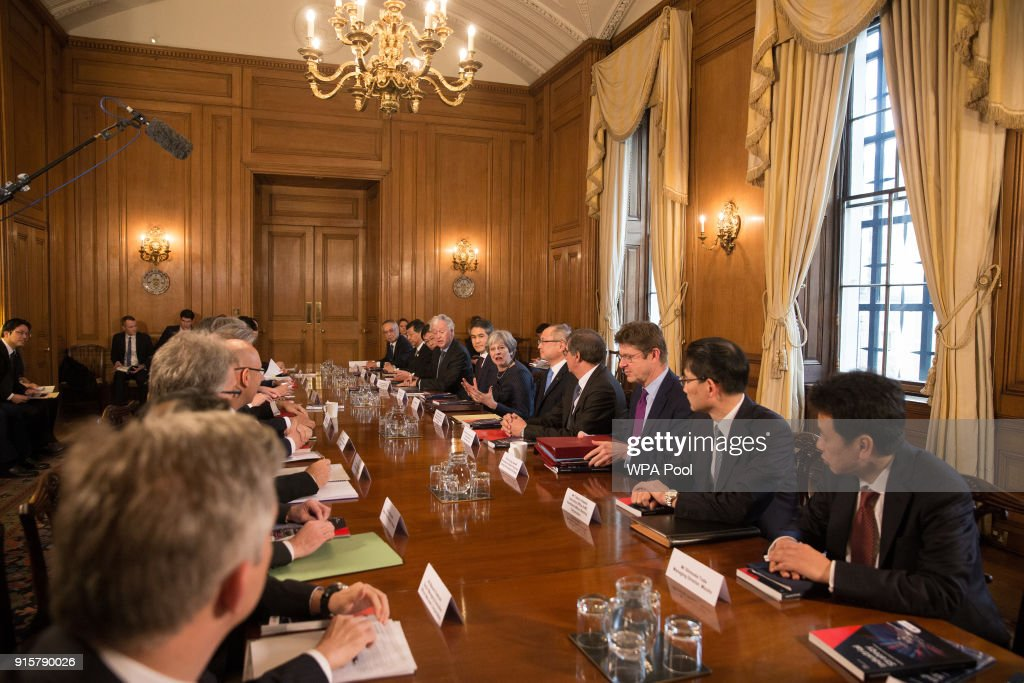 Britain's Prime Minister Theresa May (6th R) speaks as she hosts a roundtable with Japanese investors in the UK at 10 Downing Street on February 8, 2018 in London, England.