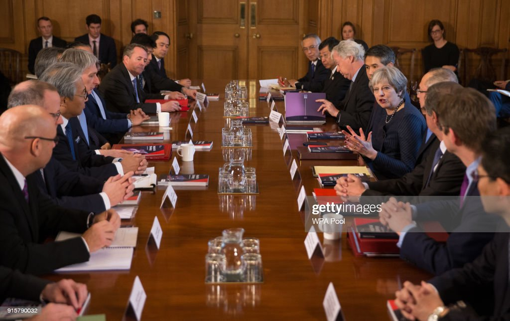 Britain's Prime Minister Theresa May (CR) speaks as she hosts a roundtable with Japanese investors in the UK at 10 Downing Street on February 8, 2018 in London, England.