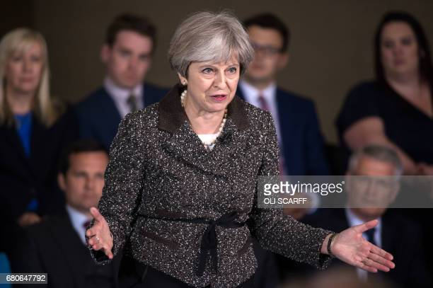Britain's Prime Minister Theresa May speaks at an election campaign meeting in York north England on May 9 2017 Britain will vote in a general...
