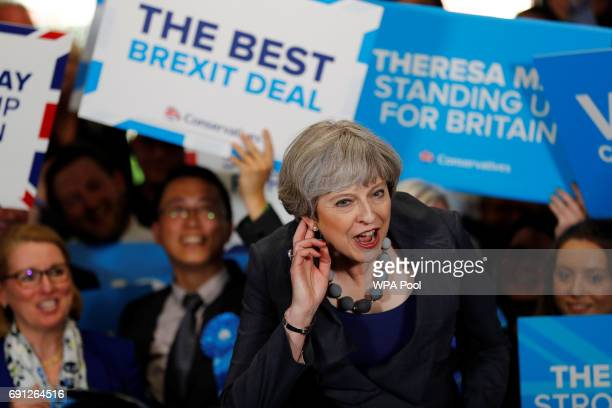 Britain's Prime Minister Theresa May speaks at an election campaign event at Pride Park Stadium on June 1 2017 in Derby United Kingdom All parties...