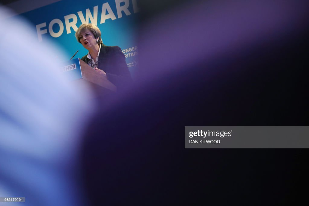 Britain's Prime Minister Theresa May speaks at the launch of the Scottish manifesto by Scottish Conservative leader Ruth Davidson in Edinburgh on May 19, 2017. / AFP PHOTO / POOL / Dan Kitwood