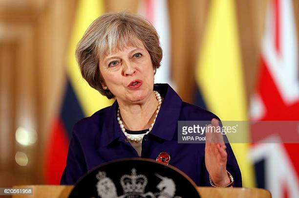 Britain's Prime Minister Theresa May speaks during a press statement with Colombia's President Juan Manuel Santos at 10 Downing Street on November 2...