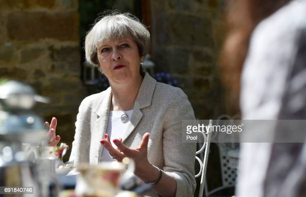 Britain's Prime Minister Theresa May speaks during an election campaign visit to Horsfields Nursery on June 3 2017 in Silkstone South Yorkshire...