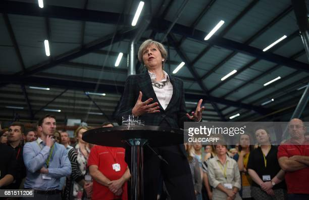Britain's Prime Minister Theresa May speaks to assembled attendees during a general election campaign event at marketing services group Linney in...