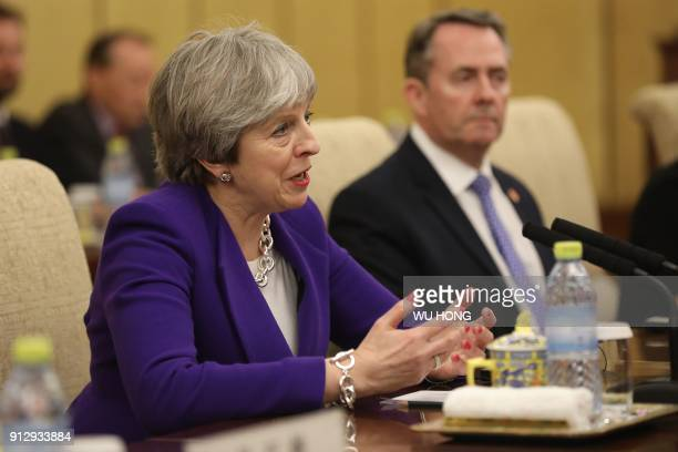 Britain's Prime Minister Theresa May speaks to Chinese President Xi Jinping during their meeting at the Diaoyutai State Guesthouse in Beijing on...