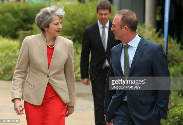 Britain's Prime Minister Theresa May speaks to head of BBC News James Harding on her arrival for the BBC One Question Time Leaders Special to be...