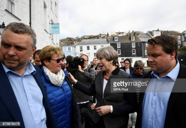 Britain's Prime Minister Theresa May speaks to locals during a campaign stop on May 2 2017 in Mevagissey Cornwall England The Prime Minister is...