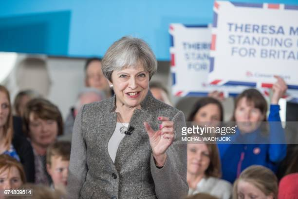 Britain's Prime Minister Theresa May speaks to supporters and guests in the village of Banchory in Aberdeenshire north east of Scotland on April 29...