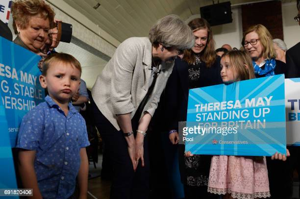 Britain's Prime Minister Theresa May speaks to supporters at an election campaign event during a visit to West Yorkshire at Thornhill Cricket and...