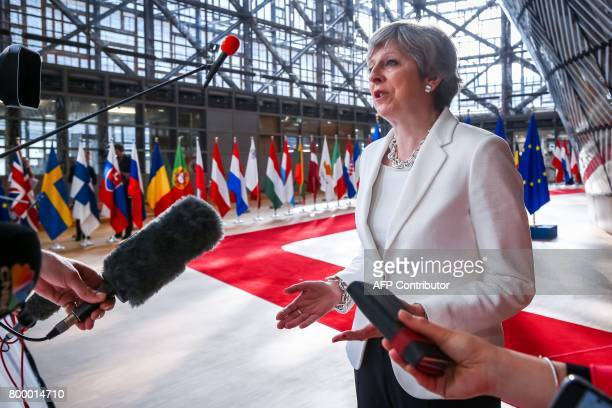 Britain's Prime Minister Theresa May speaks to the press as she arrives on the second day of a summit of European Union leaders and focusing on...