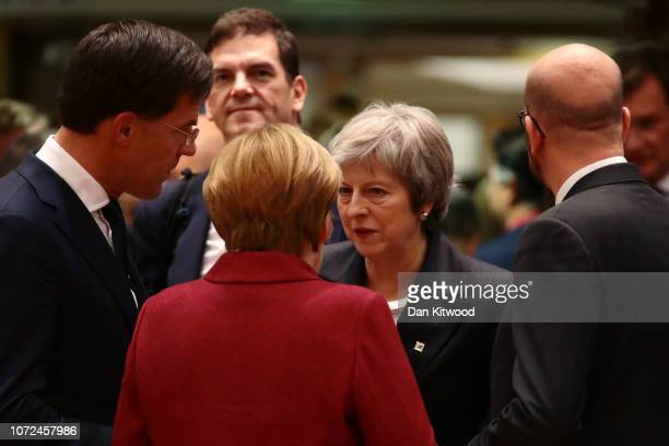 Britain's Prime Minister Theresa May speaks with Netherlands' Prime Minister Mark Rutte German Chancellor Angela Merkel and Belgian Prime Minister...