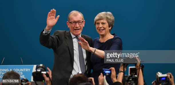Britain's Prime Minister Theresa May stands with her husband Philip May as she waves to delegates after delivering her speech on the final day of the...
