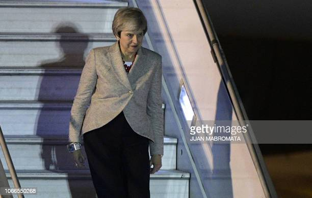 Britain's Prime Minister Theresa May steps off her plane upon arrival at Ezeiza International airport in Buenos Aires on November 29 on the eve of...