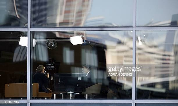 Britain's Prime Minister Theresa May takes a drink while speaking with journalist Andrew Marr during a televsion interview at the BBC studio in...