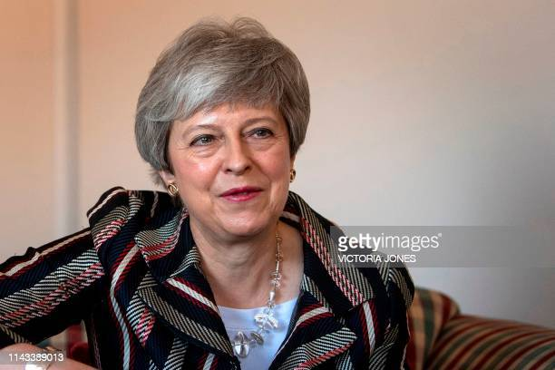 Britain's Prime Minister Theresa May talks with case workers and domestic violence survivors on a visit to a charity providing support for victims of...